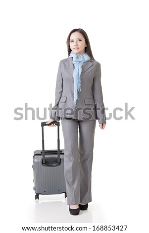Asian business woman holding a suitcase, full length portrait isolated on white background. - stock photo