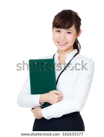 Asian business woman holding clipboard - stock photo
