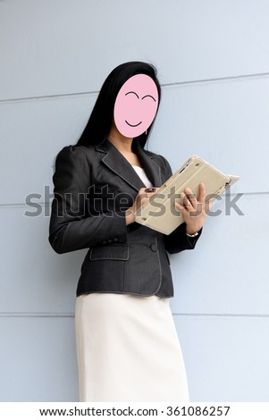 Asian business woman looking laptop. - stock photo