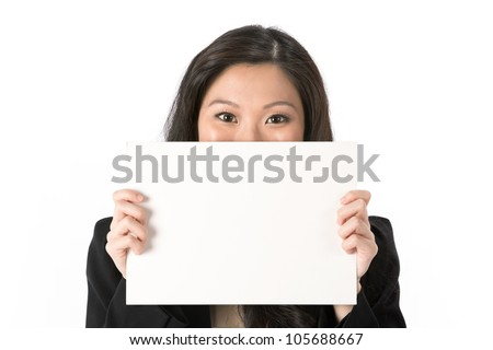 Asian Business woman looking over an empty white sign. - stock photo