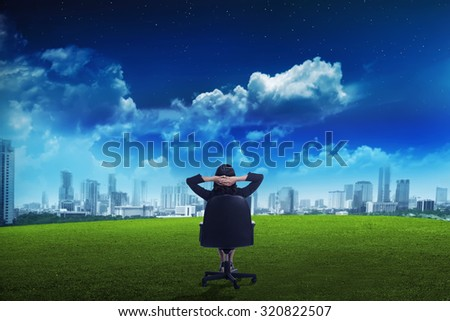 Asian business woman looking the city on the park. Business vision concept - stock photo