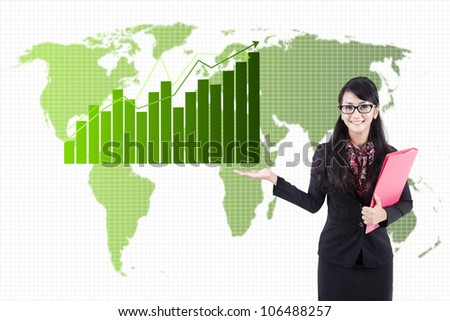 Asian business woman presenting global business statistics - stock photo