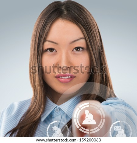 Asian business woman pressing social media icon - stock photo