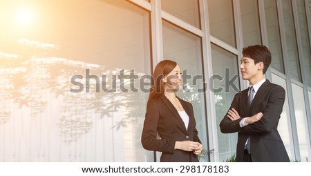 Asian business woman talk to others in the city. - stock photo