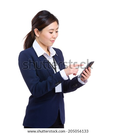 Asian business woman touch on cellphone - stock photo