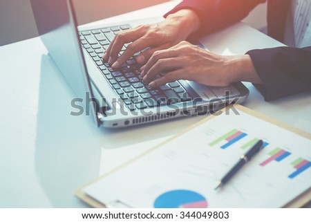 Asian business woman using laptop for online shopping.vintage tone Retro filter effect,soft focus,low light.(selective focus) - stock photo