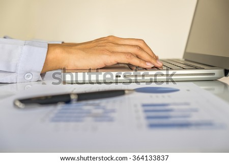 Asian business woman using laptop for online shopping.Vintage tone,Retro filter effect,Soft focus,Low light.(selective focus) - stock photo