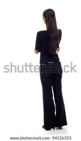 Asian business woman with arms crossed from the back - looking at something isolated over white background - stock photo