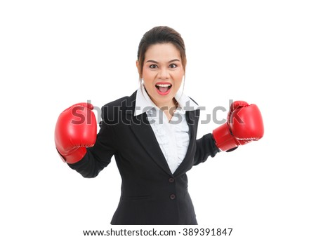 Asian business woman with boxing gloves angry isolated on white background - stock photo
