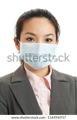 Asian business woman with face mask - stock photo
