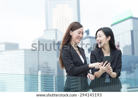 Asian business women talking to each other in Hong Kong, Asia. - stock photo