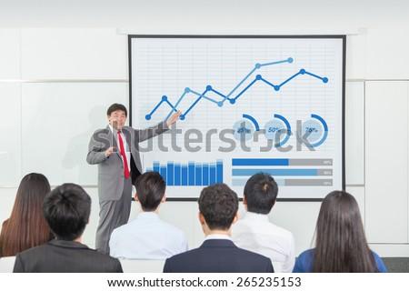 Asian businessman analyzing business growth - stock photo