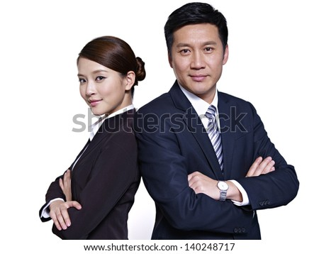 asian businessman and businesswoman standing back to back, arms crossed - stock photo