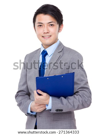 Asian businessman hold the file pad - stock photo