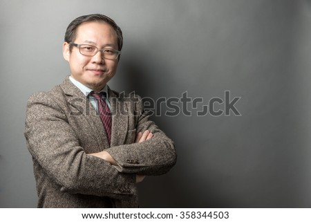 Asian Businessman in an Isolated Background - stock photo