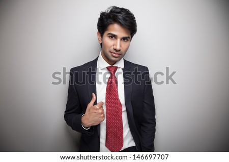 Asian businessman looking very confident - stock photo