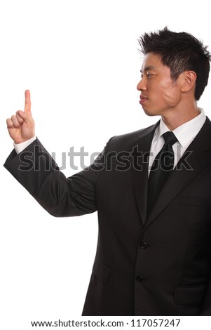 Asian Businessman pointing up isolated on white - stock photo