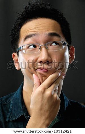 Asian businessman pondering - stock photo