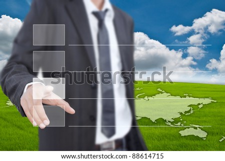 Asian businessman pushing correct choice on the blue sky. - stock photo