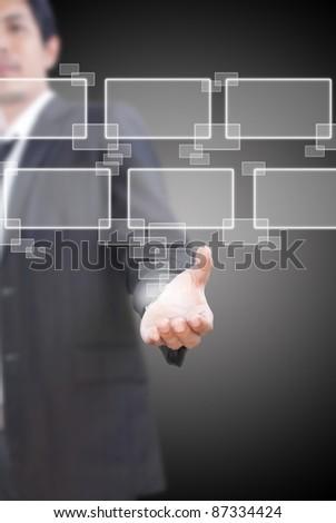 Asian businessman pushing digital button. - stock photo