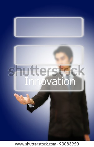 Asian businessman pushing innovation word. - stock photo