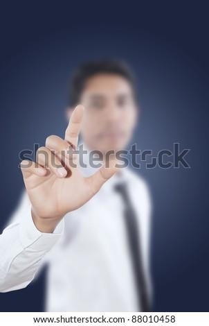 Asian businessman pushing on the whiteboard. - stock photo
