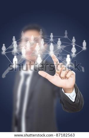 Asian businessman pushing people social network. - stock photo