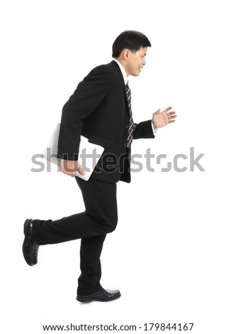 Asian businessman running for do the jobin studio with white background - stock photo