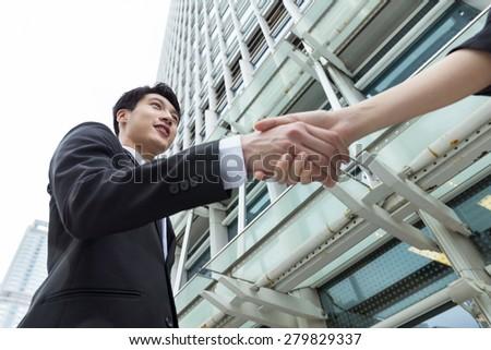 Asian businessman shaking hand - stock photo