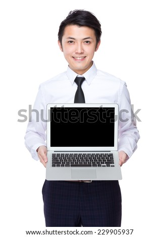 Asian Businessman show with blank screen of laptop - stock photo