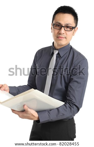 Asian businessman standing and holding a folder. Isolated on white background - stock photo