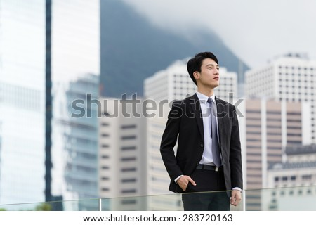 Asian businessman think  of soemthing - stock photo