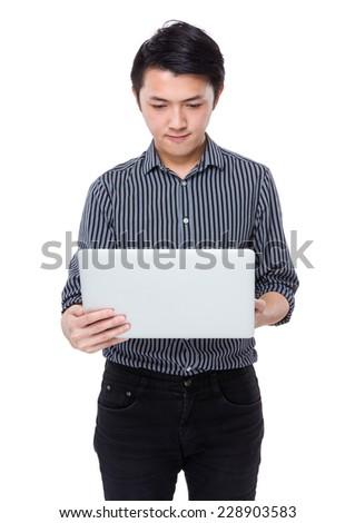 Asian businessman use of laptop - stock photo