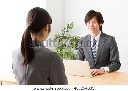 asian businessman working in the office - stock photo