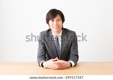 asian businessman working on the desk - stock photo