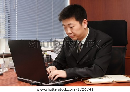 Asian businessman working with computer. - stock photo