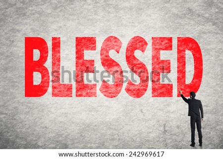 Asian businessman write text on wall, Blessed - stock photo