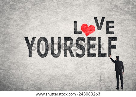 Asian businessman write text on wall, Love Yourself - stock photo