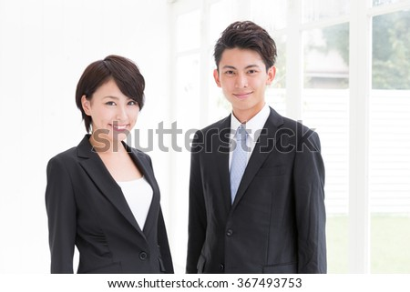asian businessperson working in the care - stock photo
