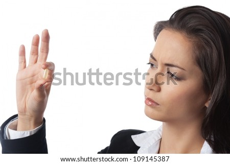 Asian Businesswoman checking medicine closely on white background - stock photo