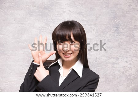 asian businesswoman counting six - stock photo