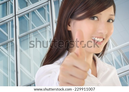 Asian businesswoman gesture with thumb up on white background. - stock photo