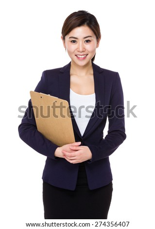 Asian businesswoman hold with clipboard - stock photo