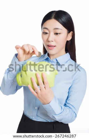 asian businesswoman holding a piggy bank . isolated on a white background - stock photo