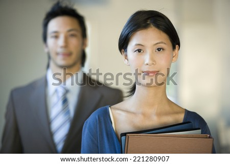 Asian businesswoman holding folders - stock photo