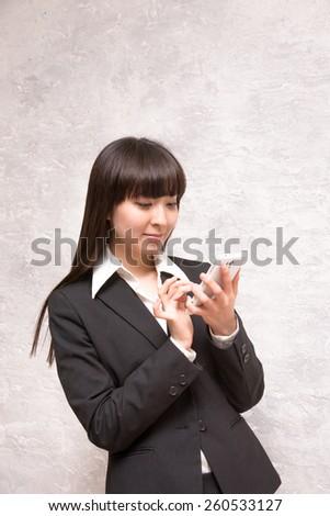 asian businesswoman holing smartphone - stock photo