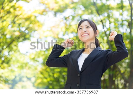 asian businesswoman in the park - stock photo