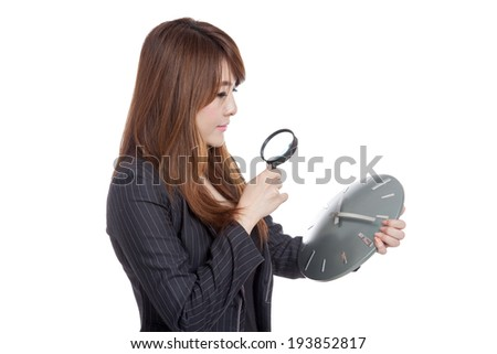 Asian Businesswoman look at a clock with magnifying glass  isolated on white background - stock photo