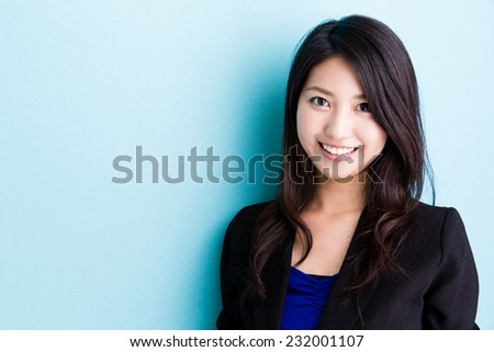 asian businesswoman on blue background - stock photo