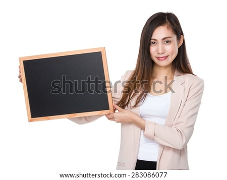 Asian businesswoman show with blackboard - stock photo